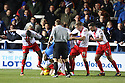 Luke Jones of Stevenage (kneeling) shields the ball<br />  - Peterborough United v Stevenage - Sky Bet League One - London Road, Peterborough - 23rd November 2013. <br /> © Kevin Coleman 2013