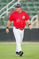 Kannapolis Intimidators manager Tommy Thompson (39) walks back to the dugout after having questioned a call at home plate during the South Atlantic League game against the Lexington Legends at CMC-Northeast Stadium on July 29, 2013 in Kannapolis, North Carolina.  The Intimidators defeated the Legends 10-5.  (Brian Westerholt/Four Seam Images)