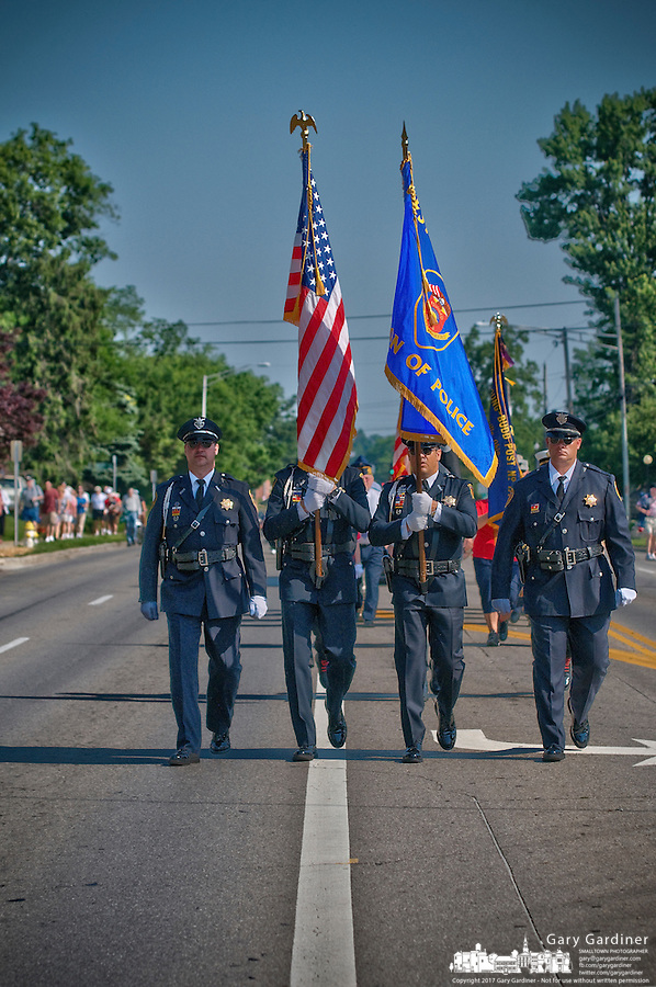 An honor guard of police officers leads the Memorial Day parade through Uptown Westerville