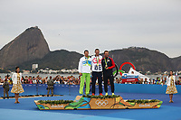 RIO DE JANEIRO, BRAZIL - AUGUST 16:  (L-R) Bronze medalist Vasilij Zbogar of Slovenia, gold medalist Giles Scott of Great Britain and bronze medalist Caleb Paine of the United States celebrate on the podium for the Finn class on Day 11 of the Rio 2016 Olympic Games at the Marina da Gloria on August 16, 2016 in Rio de Janeiro, Brazil.  (Photo by Clive Mason/Getty Images)