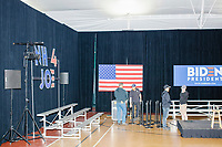 The stage crew dismantles the set after Democratic presidential candidate and former Vice President Joe Biden spoke a campaign event at The Sports Barn in Hampton, New Hampshire, on Sun., December 8, 2019.