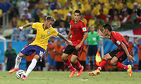 Brazil's Neymar takes on Jose Vazquez