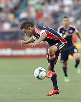 New England Revolution midfielder Diego Fagundez (14) collects a pass. In a Major League Soccer (MLS) match, the New England Revolution (blue) tied D.C. United (white), 0-0, at Gillette Stadium on June 8, 2013.