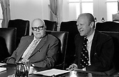 "United States President Gerald R. Ford, right, meets with George Meany, president of the American Federation of Labor–Congress of Industrial Organizations (AFL-CIO), left in the Cabinet Room of the White House in Washington, DC on Tuesday, August 26, 1975.  They were meeting with other union leaders to discuss grain sales to the U.S.S.R. and related US maritime policy.<br /> Credit: Benjamin E. ""Gene"" Forte / CNP"