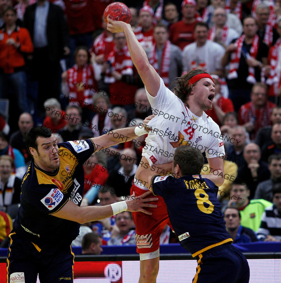 Mikkel Hansen (R) of Denmark in action during men`s EHF EURO 2012 championship semifinal handball game between Denmark and Spain in Belgrade, Serbia, Friday, January 27, 2011.  (photo: Pedja Milosavljevic / thepedja@gmail.com / +381641260959)