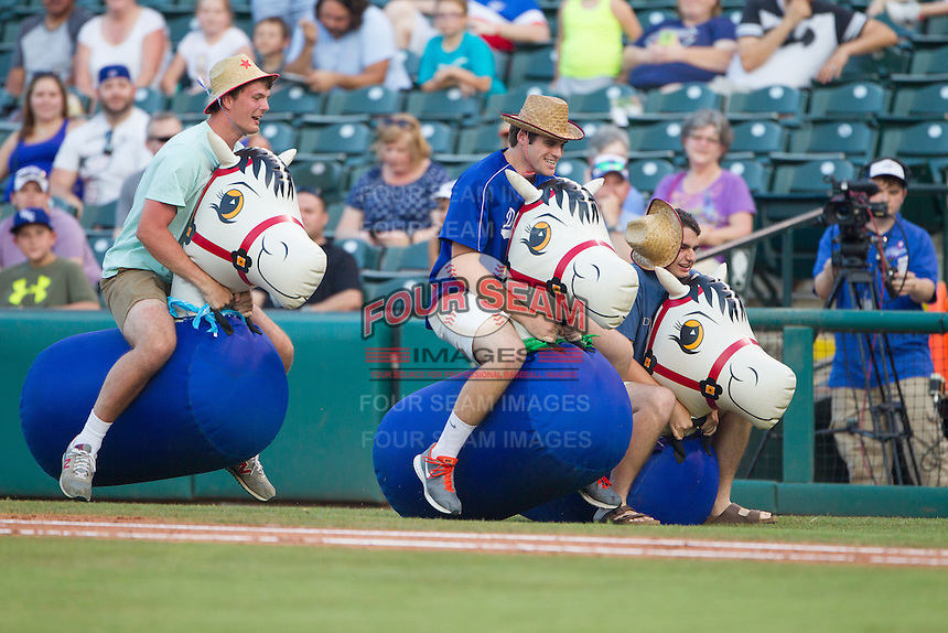 Oklahoma City Dodgers race blow up ponies between innings during a game between the Oklahoma City Dodgers and the Omaha Storm Chasers at Chickasaw Bricktown Ballpark on June 16, 2016 in Oklahoma City, Oklahoma. Oklahoma City defeated Omaha 5-4  (William Purnell/Four Seam Images)