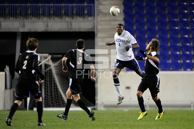 Nickardo Blake (4) of the Connecticut Huskies heads the ball. Connecticut defeated Louisville 1-0 during the first semifinal match of the Big East Men's Soccer Championships at Red Bull Arena in Harrison, NJ, on November 11, 2011.