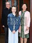 Emma Ní Shuilleabhain who was confirmed in St Mary's church pictured with grandparents Paddy and Sheila McNally. Photo:Colin Bell/pressphotos.ie