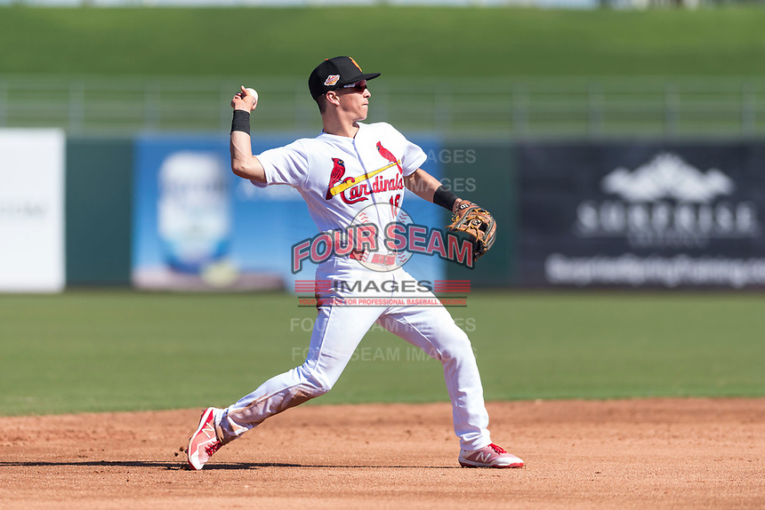 Surprise Saguaros shortstop Tommy Edman (18), of the St. Louis Cardinals organization, throws to first base during an Arizona Fall League game against the Peoria Javelinas at Surprise Stadium on October 17, 2018 in Surprise, Arizona. (Zachary Lucy/Four Seam Images)