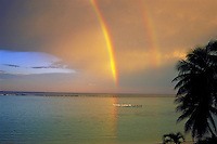 Outrigger canoes w/ rainbows, Tumon Bay, Guam
