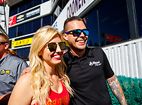 Feb 11, 2018; Pomona, CA, USA; NHRA funny car driver Courtney Force (left) with Jonnie Lindberg during the Winternationals at Auto Club Raceway at Pomona. Mandatory Credit: Mark J. Rebilas-USA TODAY Sports