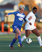 Boston Breakers midfielder Joanna Lohman (11) battles for the ball with Washington Spirit forward Tiffany McCarty (14). In a National Women's Soccer League Elite (NWSL) match, the Boston Breakers (blue) tied the Washington Spirit (white), 1-1, at Dilboy Stadium on April 14, 2012.