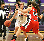 SIOUX FALLS, SD - DECEMBER 8:  Madi Robson #10 from the University of Sioux Falls tries to drive past Shyla Carr #24 from Minot State Friday night at the Stewart Center.(Photo by Dave Eggen/Inertia)