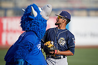 San Antonio Missions shortstop Jose Rondon (13) jokes around with mascot Hornsby before a game against the Tulsa Drillers on June 1, 2017 at ONEOK Field in Tulsa, Oklahoma.  Tulsa defeated San Antonio 5-4 in eleven innings.  (Mike Janes/Four Seam Images)