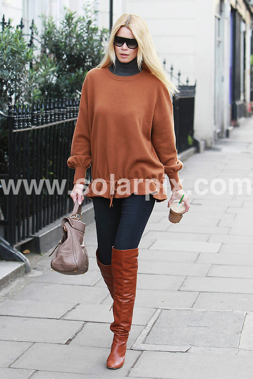 **ALL ROUND PICTURES FROM SOLARPIX.COM**                                             **WORLDWIDE SYNDICATION RIGHTS**                                                                                  Caption: Claudia Schiffer walking around Notting Hill in London, UK. 24 November 2010                                                                           This pic: Claudia Schiffer                                                                                             JOB REF: 12520 LNJ       DATE: 24_11_2010                                                           **MUST CREDIT SOLARPIX.COM OR DOUBLE FEE WILL BE CHARGED**                                                                      **MUST AGREE FEE BEFORE ONLINE USAGE**                               **CALL US ON: +34 952 811 768 or LOW RATE FROM UK 0844 617 7637**