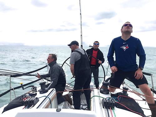 Indian's crew sorting themselves for a gybe are (left to right) John Flynn, Simon Knowles, Cillian Macken on helm, and Jon Hartshorn.