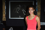 Fine artist, dancer, actress, Cajai Fellows Johnson poses in front of her pencil drawing, at the Art of Persuasion event at Beautique on 8 West 58 Street, in New York City on November 19, 2016.