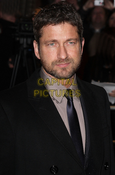 GERARD BUTLER .Attending the Opening Night of 'Love Never Dies' at the Adelphi Theatre, The Strand, London, England, UK, .March 9th 2010..arrivals portrait headshot beard facial hair black suit tie shirt navy blue brown .CAP/ROS.©Steve Ross/Capital Pictures.