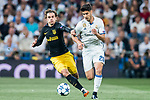 Marco Asensio Willemsen (r) of Real Madrid fights for the ball with Antoine Griezmann of Atletico de Madrid during their 2016-17 UEFA Champions League Semifinals 1st leg match between Real Madrid and Atletico de Madrid at the Estadio Santiago Bernabeu on 02 May 2017 in Madrid, Spain. Photo by Diego Gonzalez Souto / Power Sport Images