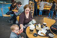 A mother looks after her son while breastfeeding her baby in a museum cafe.<br /> <br /> London, England, UK<br /> 08/03/2015<br /> <br /> &copy; Paul Carter / wdiip.co.uk