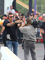 Apr 24, 2015; Baytown, TX, USA; Television personality Richard Rawlings reacts as he watches NHRA top fuel dragster qualifying for the Spring Nationals at Royal Purple Raceway. Mandatory Credit: Mark J. Rebilas-