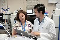 Robert Machuca '20 works with Dr. Karine Bagramyan, Staff Scientist at City of Hope National Medical Center.<br /> Occidental College students work at City of Hope National Medical Center in Duarte as part of InternLA, July 24, 2018.<br /> Career Services' InternLA is a paid summer internship program which helps Oxy students gain real-world work experience from actual businesses in Los Angeles and surrounding area.<br /> (Photo by Marc Campos, Occidental College Photographer)