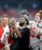 Ohio State Buckeyes running back Ezekiel Elliott (15) looks at the Fiesta Bowl trophy after beating Notre Dame Fighting Irish during the Fiesta Bowl in the University of Phoenix Stadium on January 1, 2016.  (Dispatch photo by Kyle Robertson)