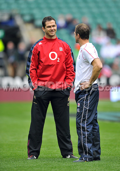 England coach Andy Farrell has a word with Mike Catt during the pre-match warm-up. QBE International match between England and Australia on November 17, 2012 at Twickenham Stadium in London, England. Photo by: Patrick Khachfe / Onside Images