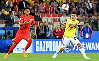 MOSCU - RUSIA, 03-07-2018: Juan QUINTERO (Der) jugador de Colombia disputa el balón con Jesse LINGARD (Izq) jugador de Inglaterra durante partido de octavos de final por la Copa Mundial de la FIFA Rusia 2018 jugado en el estadio del Spartak en Moscú, Rusia. / Juan QUINTERO (R) player of Colombia fights the ball with Jesse LINGARD (L) player of England during match of the round of 16 for the FIFA World Cup Russia 2018 played at Spartak stadium in Moscow, Russia. Photo: VizzorImage / Julian Medina / Cont