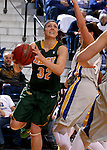 BROOKINGS, SD - JANUARY 31:  Marena Whittle #32 from North Dakota State University drives to the basket against Ellie Thompson #45 from South Dakota State University in the first half of their game Saturday afternoon at Frost Arena in Brookings. (Photo by Dave Eggen/Inertia)