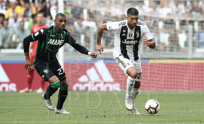 Calcio, Serie A: Juventus - Sassuolo, Turin, Allianz Stadium, September 16, 2018.<br /> Juventus' Cristiano Ronaldo (r) in action with Sassuolo's Kevin Prince Boateng (l) during the Italian Serie A football match between Juventus and  Sassuolo at Torino's Allianz stadium, September 16, 2018.<br /> UPDATE IMAGES PRESS/Isabella Bonotto