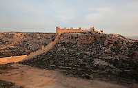 The Jairan Wall in the Hoya ravine, built under King Jairan, 1012-28, and the San Cristobal Hill or Monte Laham, with the statue of the Sacred Heart of Jesus, in the Alcazaba, a 10th century fortified enclosure and royal residence in Almeria, Andalusia, Southern Spain. The Alcazaba itself was begun in 955 by Rahman III and completed by Hayran, Taifa king of Almeria, in the 11th century. It was later added to by the Catholic monarchs. Picture by Manuel Cohen