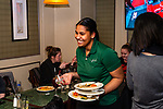 WATERBURY, CT. 11 January 2019-011119 - Kassandra Lopes of Waterbury who is a busser at Verdi's Restaurant at the Western Hills Golf Club in Waterbury clears away the dishes from patrons on Friday. Bill Shettle Republican-American