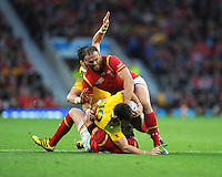 Jamie Roberts of Wales nails Bernard Foley of Australia during Match 35 of the Rugby World Cup 2015 between Australia and Wales - 10/10/2015 - Twickenham Stadium, London<br /> Mandatory Credit: Rob Munro/Stewart Communications