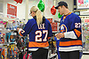 "Anders Lee of the New York Islanders and Grace Dooley browse the aisles for presents at Toys ""R"" Us in Carle Place during the team's holiday shopping for children in hospitals on Thursday, Nov. 30, 2017. The gifts will be hand-delivered by the players to children in eight local hospitals on Monday, Dec. 18."