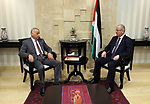 Palestinian Prime Minister Rami Hamdallah meets with a head of the supreme judicial council, advisor Emad Salim, in the West Bank city of Ramallah, on August 6, 2017. Photo by Prime Minister Office