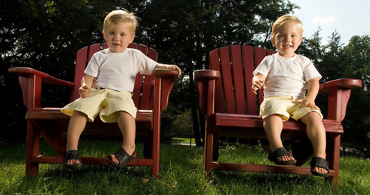 Twin Baby Brothers having fun playing in a park and on rocks