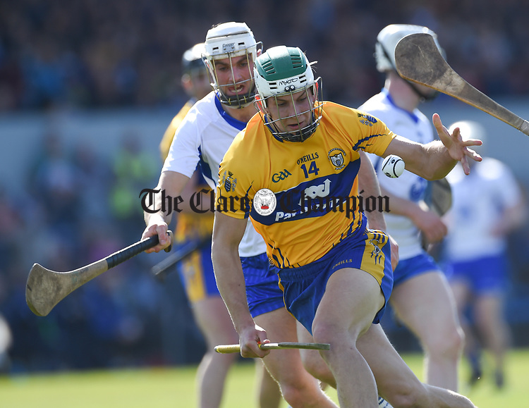 Aron Shanagher of Clare  in action against Shane Fives of Waterford during their National League game at Cusack Park. Photograph by John Kelly.