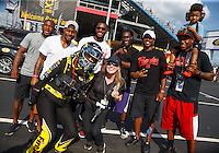 Sep 16, 2016; Concord, NC, USA; NHRA top fuel driver Leah Pritchett poses with members of the Carolina Panthers football team during qualifying for the Carolina Nationals at zMax Dragway. Mandatory Credit: Mark J. Rebilas-USA TODAY Sports
