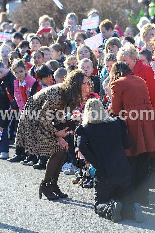 **ALL ROUND PICTURES FROM SOLARPIX.COM**                                             **WORLDWIDE SYNDICATION RIGHTS**                                                                                  Caption:Catherine Duchess of cambridge first visit of the day was to Rose Hill Primary School, where she donned a special pinny with the name 'Miss Catherine' embroidered on the front..The area is one of the most deprived in the country and of the 340 pupils at the school 48 per cent speak English as a second language and 50 per cent have a special need..This pic:Catherine Duchess of cambridge                                                                                              JOB REF: 14490       MSR       DATE: 21.02.2012                                                           **MUST CREDIT SOLARPIX.COM OR DOUBLE FEE WILL BE CHARGED**                                                                      **MUST AGREE FEE BEFORE ONLINE USAGE**                               **CALL US ON: +34 952 811 768 or LOW RATE FROM UK 0844 617 7637**