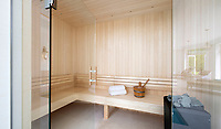 BNPS.co.uk (01202 558833)<br /> Pic: Savills/BNPS<br /> <br /> Sauna.<br /> <br /> Fairway to Heaven - Hills End has been described as 'a fabulous new masterpiece'. <br /> <br /> This breathtaking brand new mansion only a pitching wedge from one the most exclusive golf clubs in the country has emerged for sale for a whopping £22m.<br /> <br /> Hills End nestles within the prestigious Sunningdale estate in Surrey, home of the £4,000 a year Sunningdale Golf Club which dates back to 1900 and has hosted the Women's British Open and the Senior Open Championship.<br /> <br /> The newly-built property sits on a 1.75 acre plot  boasting six bedrooms, eight reception areas, a swimming pool complex with spa, sauna and yoga rooms along with a large cinema. and walk in wardrobes.<br /> <br /> The incredible Palladian style home is on the market with estate agents Savills who describe it as 'a fabulous new masterpiece'...that comes with a whopping £22 million price tag.