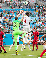 CHARLOTTE, NC - JUNE 23: Milan Borjan #18 goes up for a save over Derek Cornelius #4 during a game between Cuba and Canada at Bank of America Stadium on June 23, 2019 in Charlotte, North Carolina.