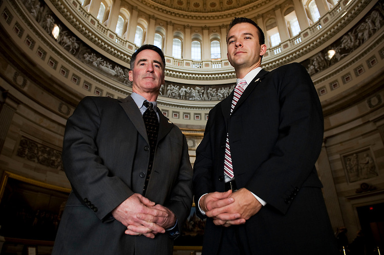 U.S Capitol Police special agents Noel Gleason, left, and Shannon Croom, right, pose together in the Rotunda of the U.S. Capitol on Thursday, Jan. 29, 2009. Croom donated part of his liver to Gleason, who suffered from a chronic liver disease, in July of 2008