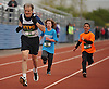 Runners leg out the final stretch of the 2016 Long Island Marathon Weekend's 1 mile race inside Mitchel Athletic Complex on Saturday, Apr. 30, 2016.