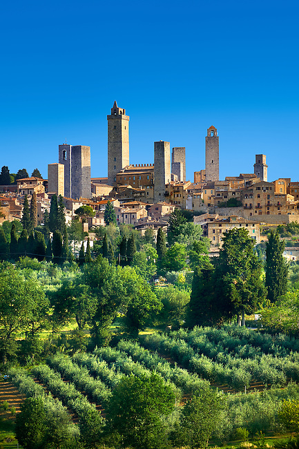 The 13th century medieval wall and towers of San Gimignano. Originally San Gimignano had  70 towers built for protection as a result of feuding families who supported the opposing Guelphs and Ghibellines. Today 12 survive in San Gimignano creating what is called the medieval Manhattan. A UNESCO World Heritage Sites. San Gimignano, Tuscany Italy