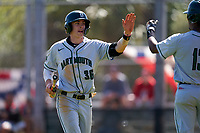 Dartmouth Big Green Trevor Johnson (36) high fives teammates after scoring a run during a game against the Omaha Mavericks on February 23, 2020 at North Charlotte Regional Park in Port Charlotte, Florida.  Dartmouth defeated Omaha 8-1.  (Mike Janes/Four Seam Images)