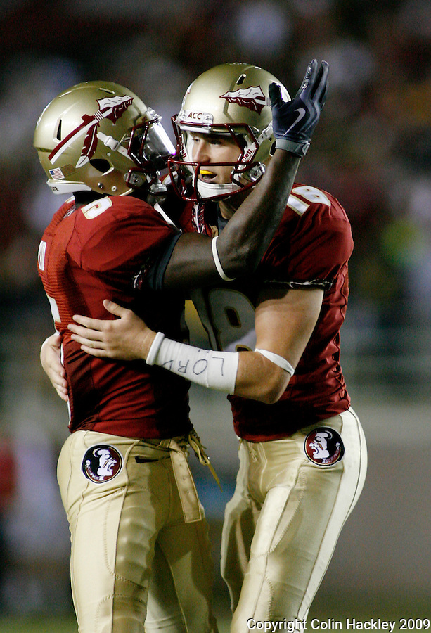 TALLAHASSEE, FL 9/7/09-FSU-MIAMIFB09 CH19-Florida State's Dustin Hopkins, right, celebrates making a 45 yard field goal against Miami with Greg Reid, during second half action Monday at Doak Campbell Stadium in Tallahassee. The Seminoles lost to the Hurricanes 38-34...COLIN HACKLEY PHOTO