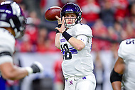 Indianapolis, IN - DEC 1, 2018: Northwestern Wildcats quarterback Clayton Thorson (18) from the pocket during first half action of the Big Ten Championship game between Northwestern and Ohio State at Lucas Oil Stadium in Indianapolis, IN. (Photo by Phillip Peters/Media Images International)