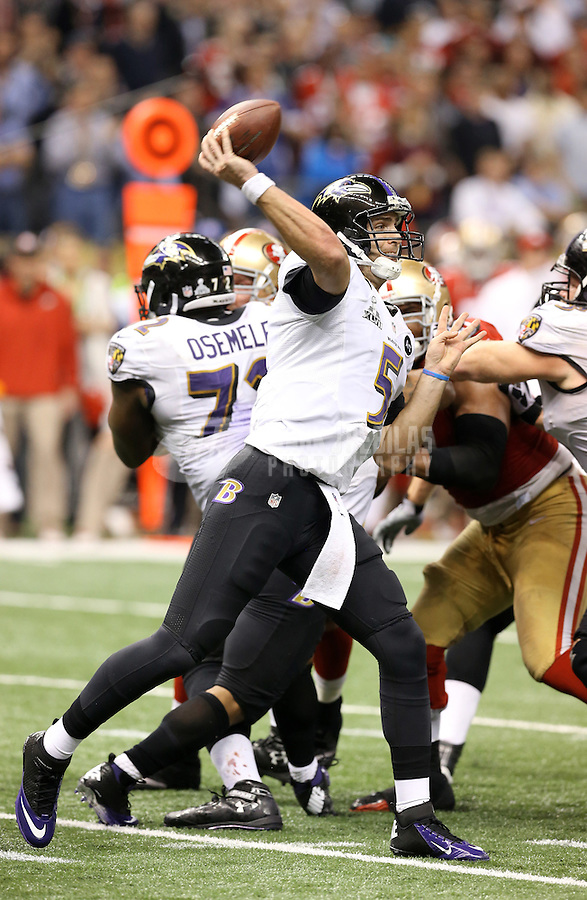 Feb 3, 2013; New Orleans, LA, USA; Baltimore Ravens quarterback Joe Flacco (5) throws a pass against the San Francisco 49ers in Super Bowl XLVII at the Mercedes-Benz Superdome. Mandatory Credit: Mark J. Rebilas-