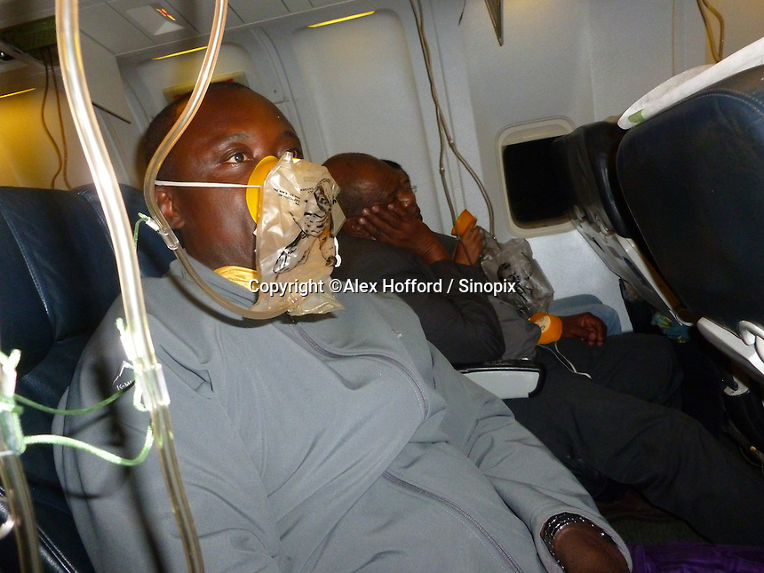 A photo taken by a passenger of Ethiopian Airlines flight ET609 from Hong Kong to Addis Ababa shows an unidentified passenger wearing an oxygen mask during a two hour diverted flight back to Hong Kong, China, 14 June 2014. According to passengers, the aircraft lost cabin pressure, dumped fuel over the ocean, and had to return back to Hong Kong where ten fire trucks as well as other emergency service vehicles were waiting. The plane landed safely, and no one was hurt.